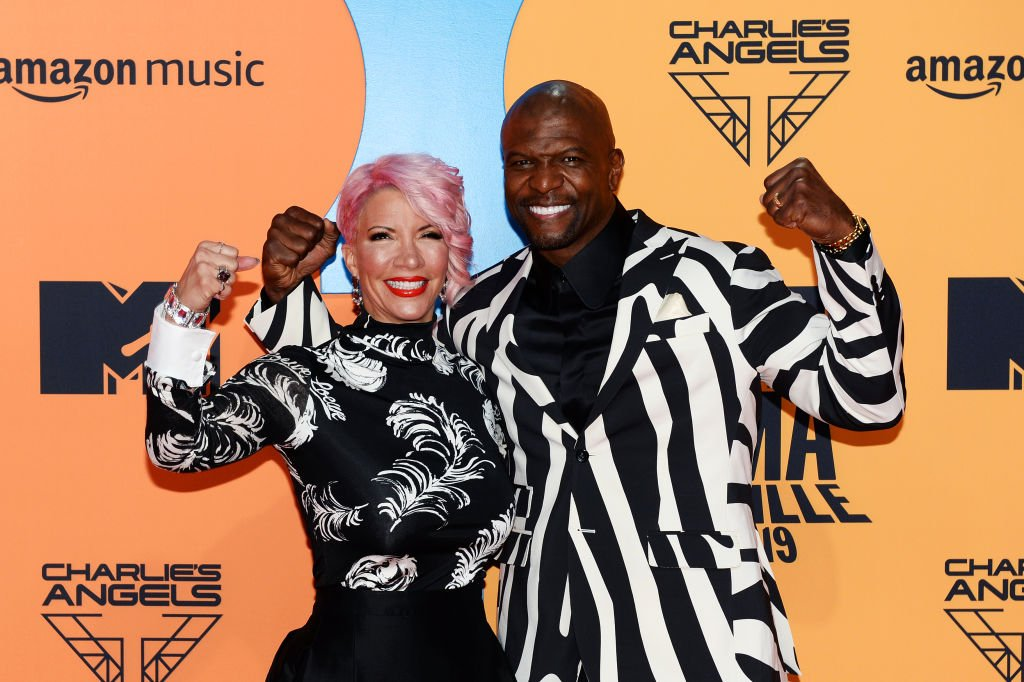 Rebecca Crews and Terry Crews pose with the arms in the air as the arrived at the MTV EMA Awards on November 03, 2019, in Seville, Spain | Source: Kate Green/Getty Images for MTV