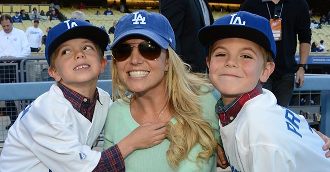 Britney Spears poses with sons Jayden James Federline and Sean Preston Federline during a game against the San Diego Padres at Dodger Stadium, April 2013 | Source: Getty Images
