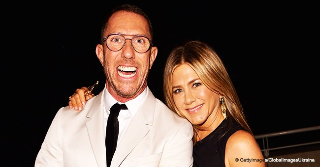 Jennifer Aniston poses topless in a rare photo while hugging her tattooed friend as she turns 50