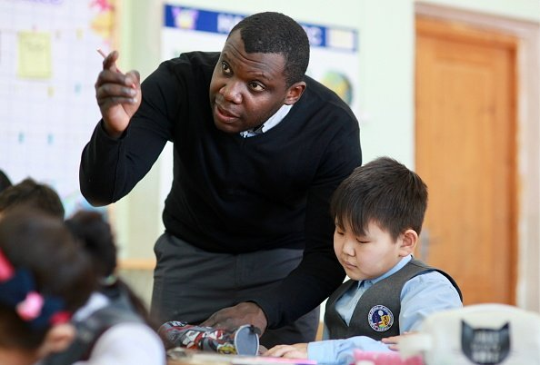 Nigerian-born teacher during a Chinese language lesson at a secondary comprehensive school | Photo: Getty Images
