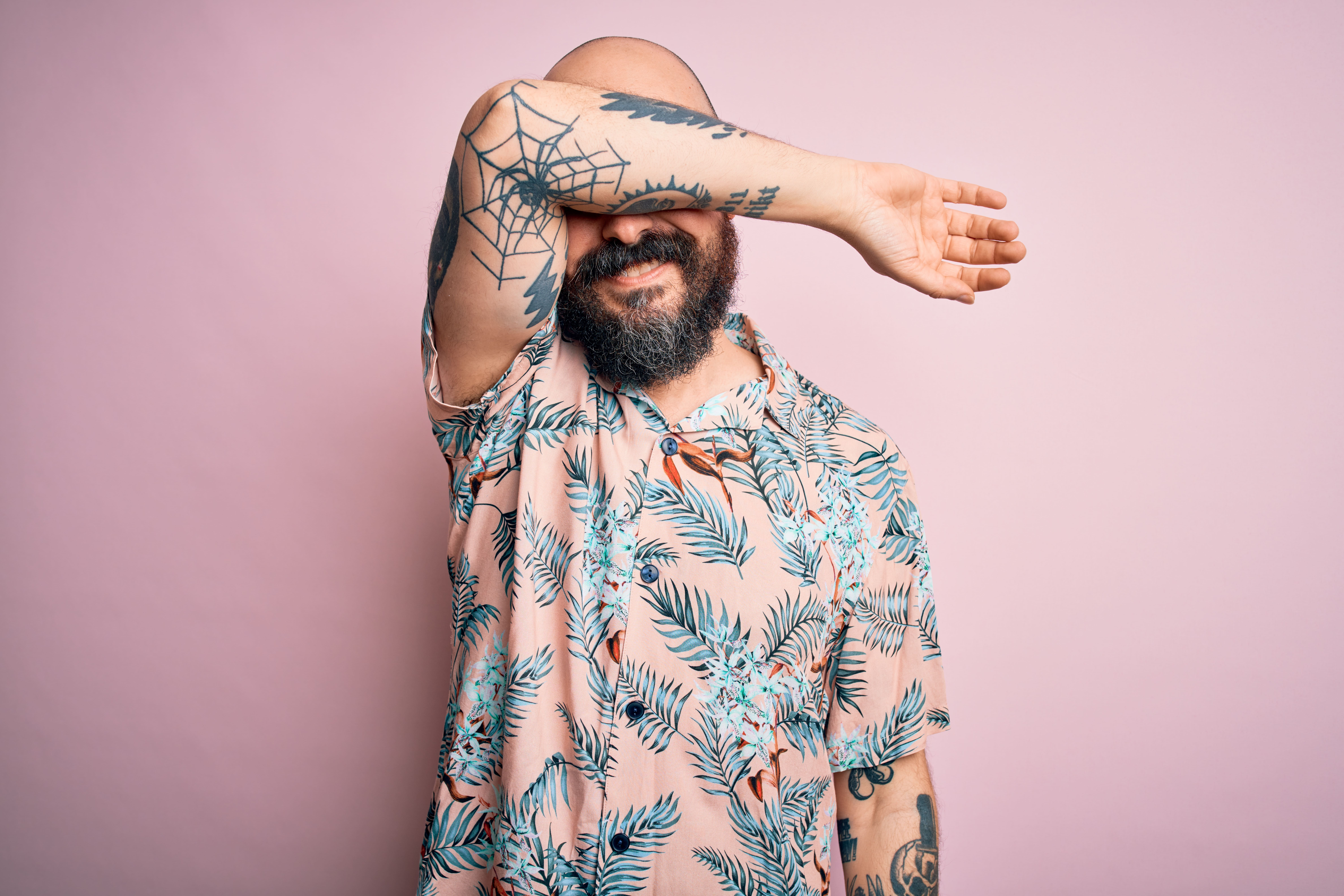 Man with tattooed arm | Shutterstock