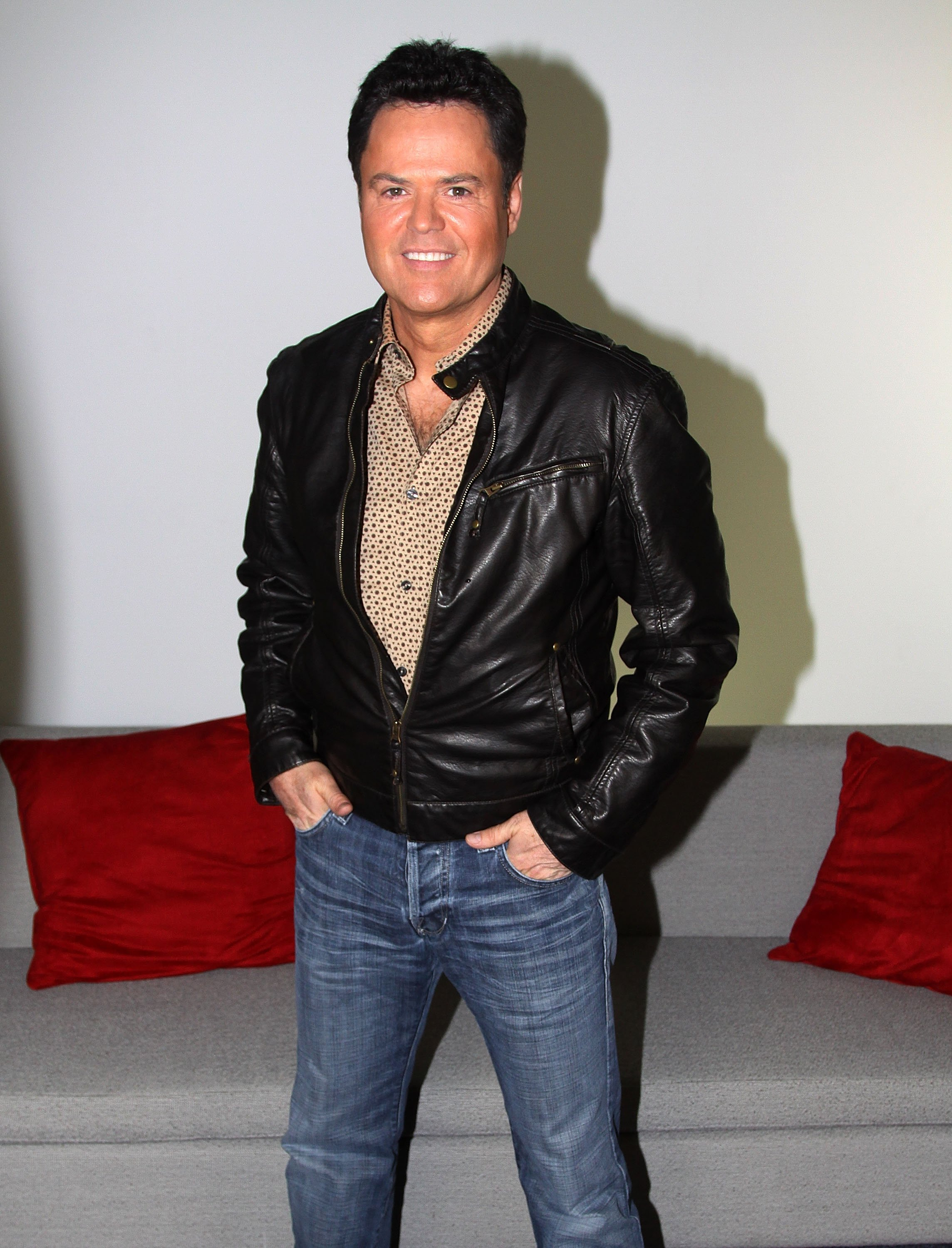 "Donny Osmond poses for the promo of ""A Broadway Christmas"" in New York City on December 8, 2010 
