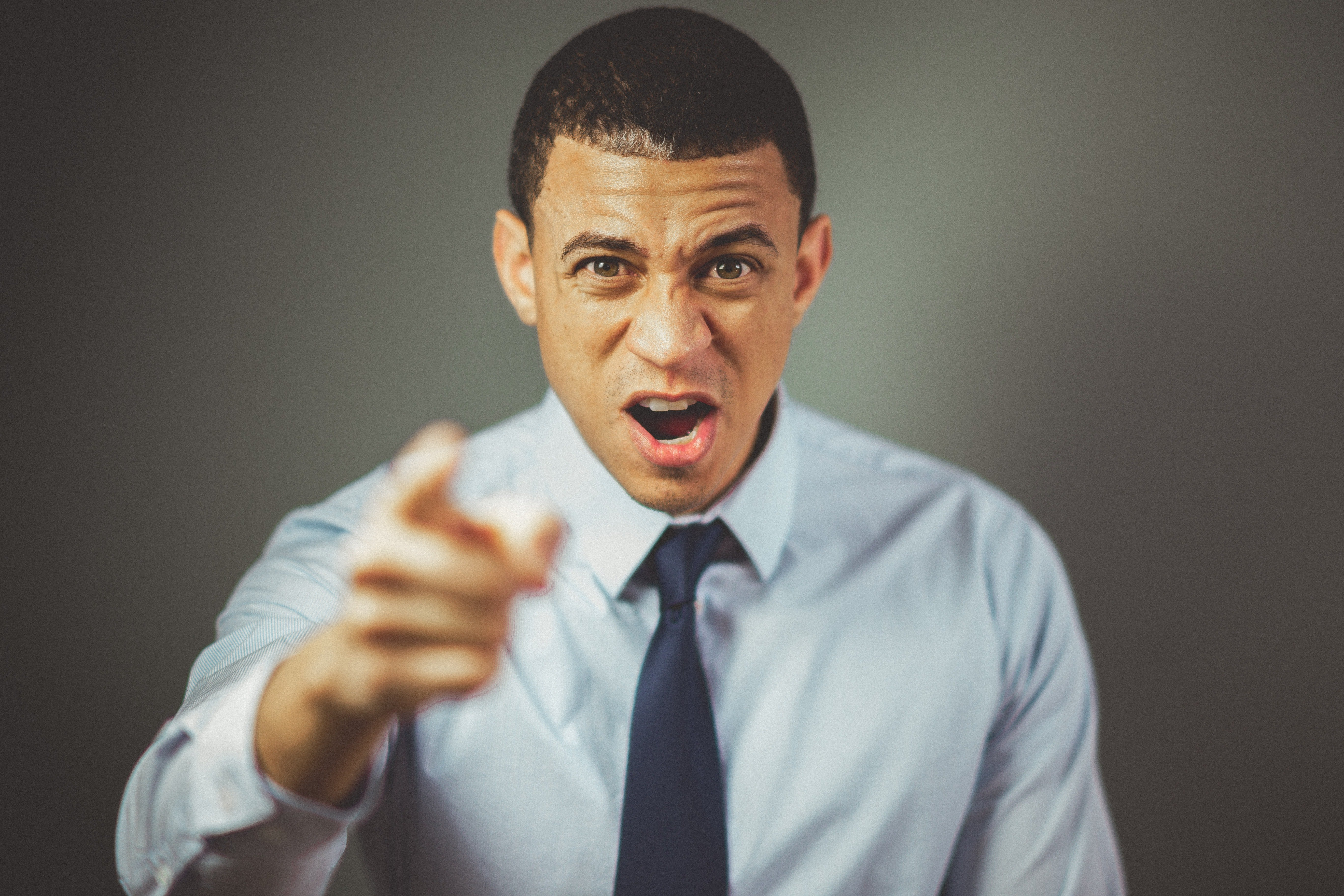 An angry man pointing his forefinger in front of him. | Photo: Pexels