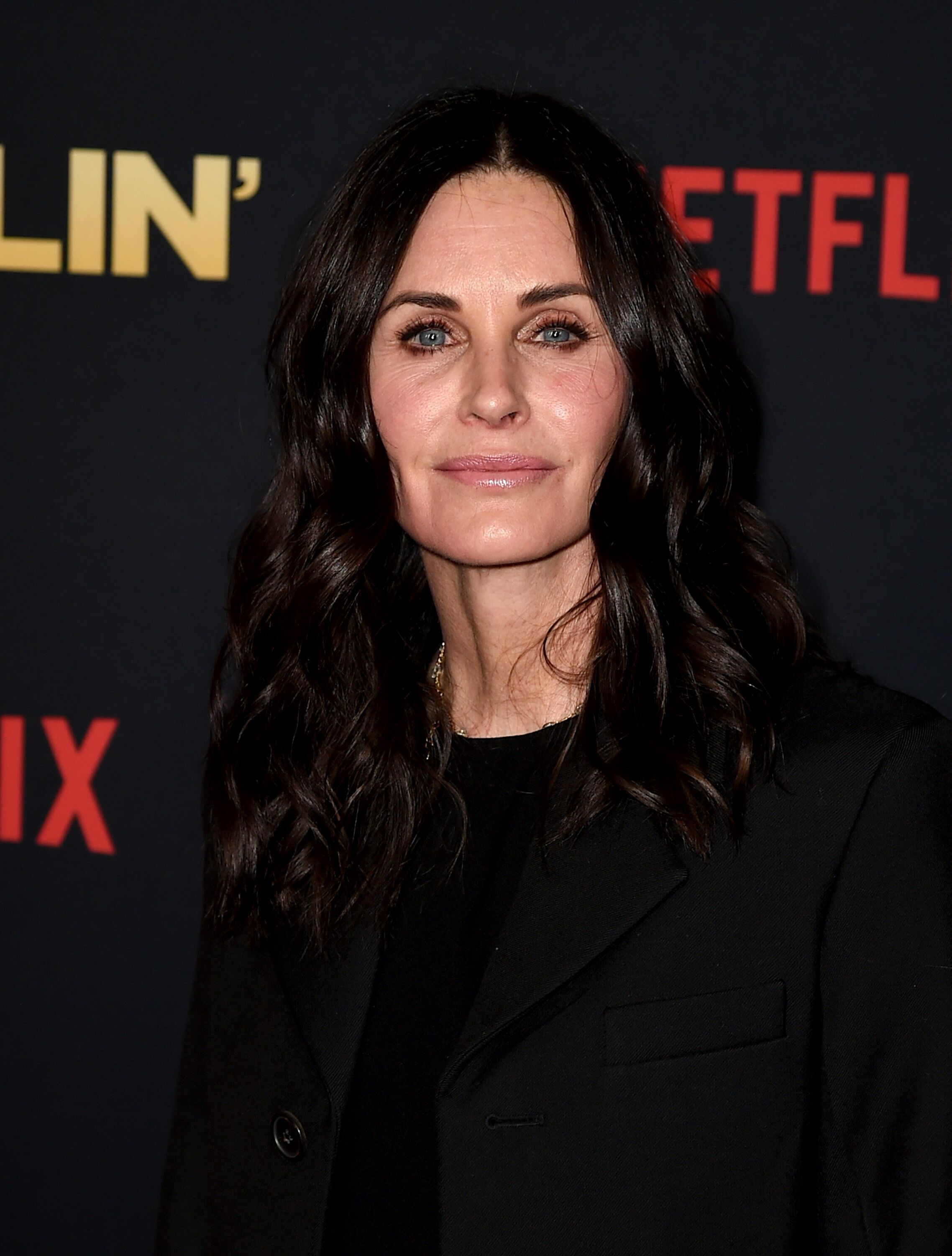 """Courteney Cox arrives at the premiere of Netflix's """"Dumplin'"""" at the Chinese Theater. 