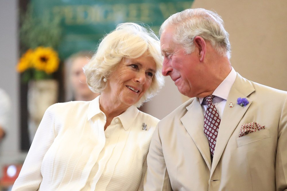Prince Charles and Camilla Parker-Bowles at the reopening the newly-renovated Strand Hall during day three of a visit to Wales in 2018. | Image: Getty Images
