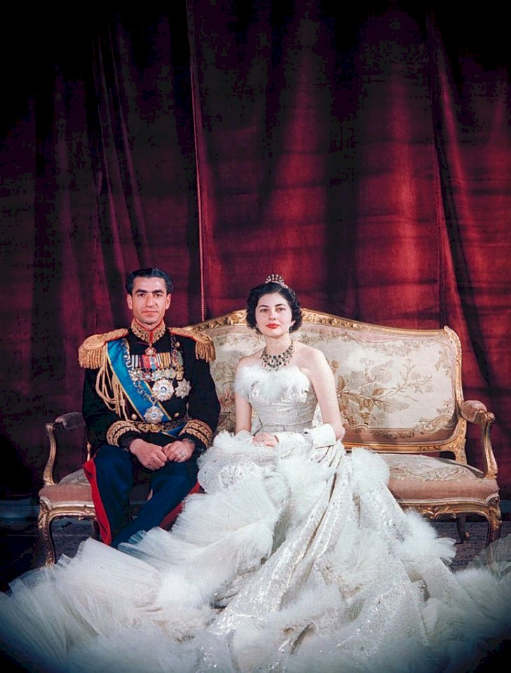 Shah Mohamed Reza Pahlevi (R), in full military attire, w. Queen Soraya (L), wearing dress designed by Christian Dior, for formal wedding portrait. (Photo by Dmitri Kessel/The LIFE Picture Collection via Getty Images)