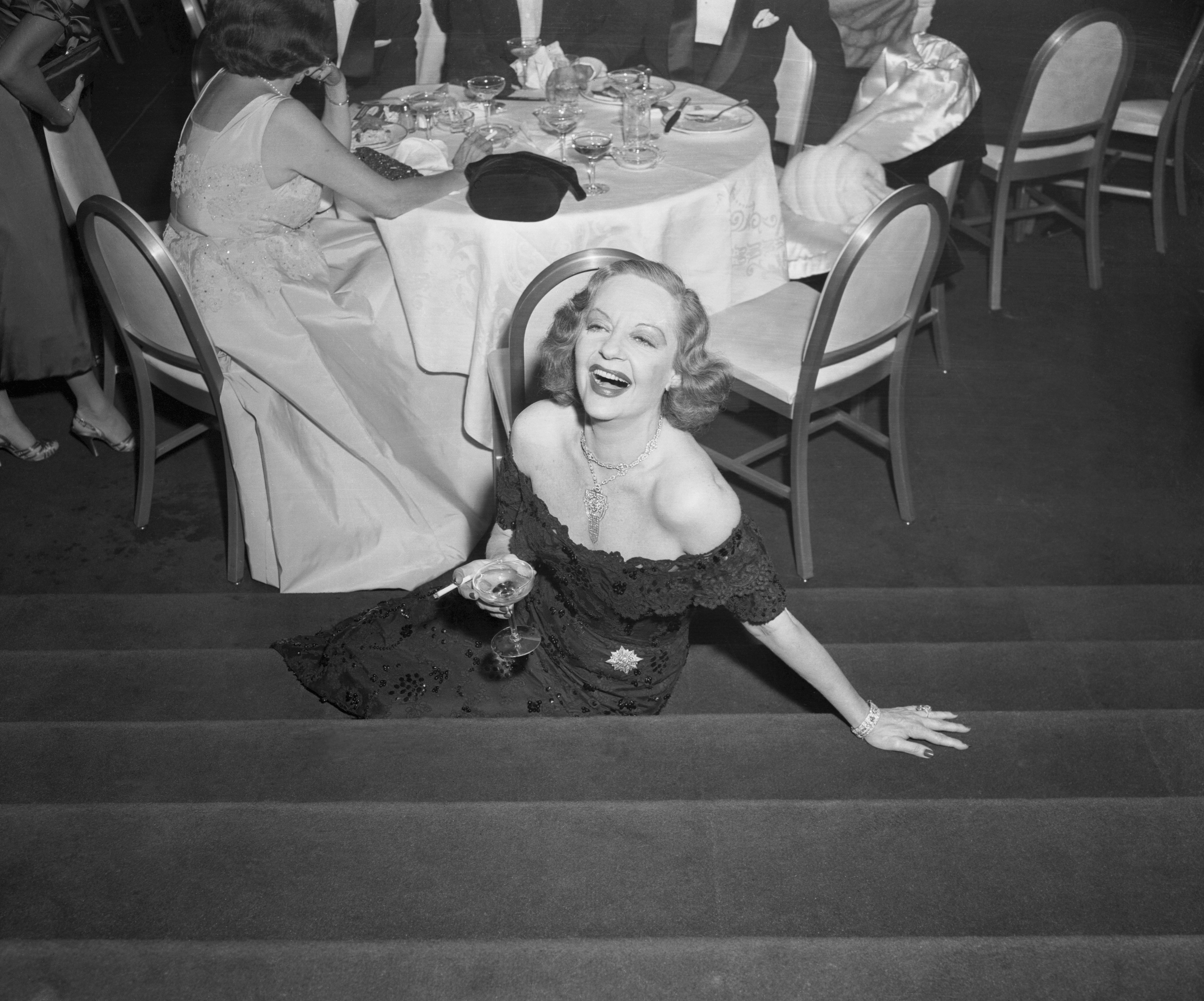 Tallulah Bankhead pictured at Hotel Ambassador in New York circa 1954 | Source: Getty Images