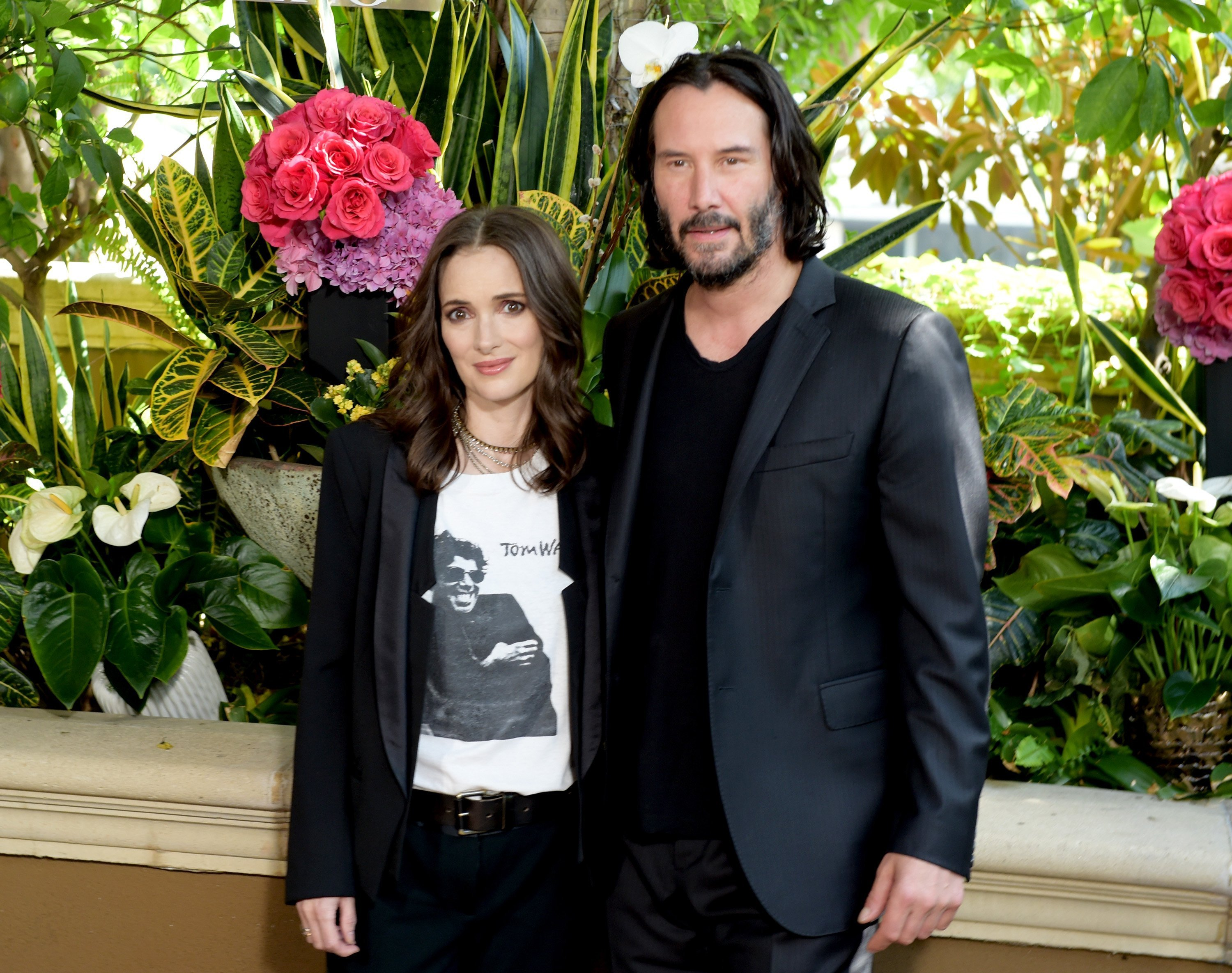 "Winona Ryder (L) and Keanu Reeves attend a photo call for Regatta's ""Destination Wedding"" at the Four Seasons Hotel Los Angeles at Beverly Hills on August 18, 2018, in Los Angeles, California. 