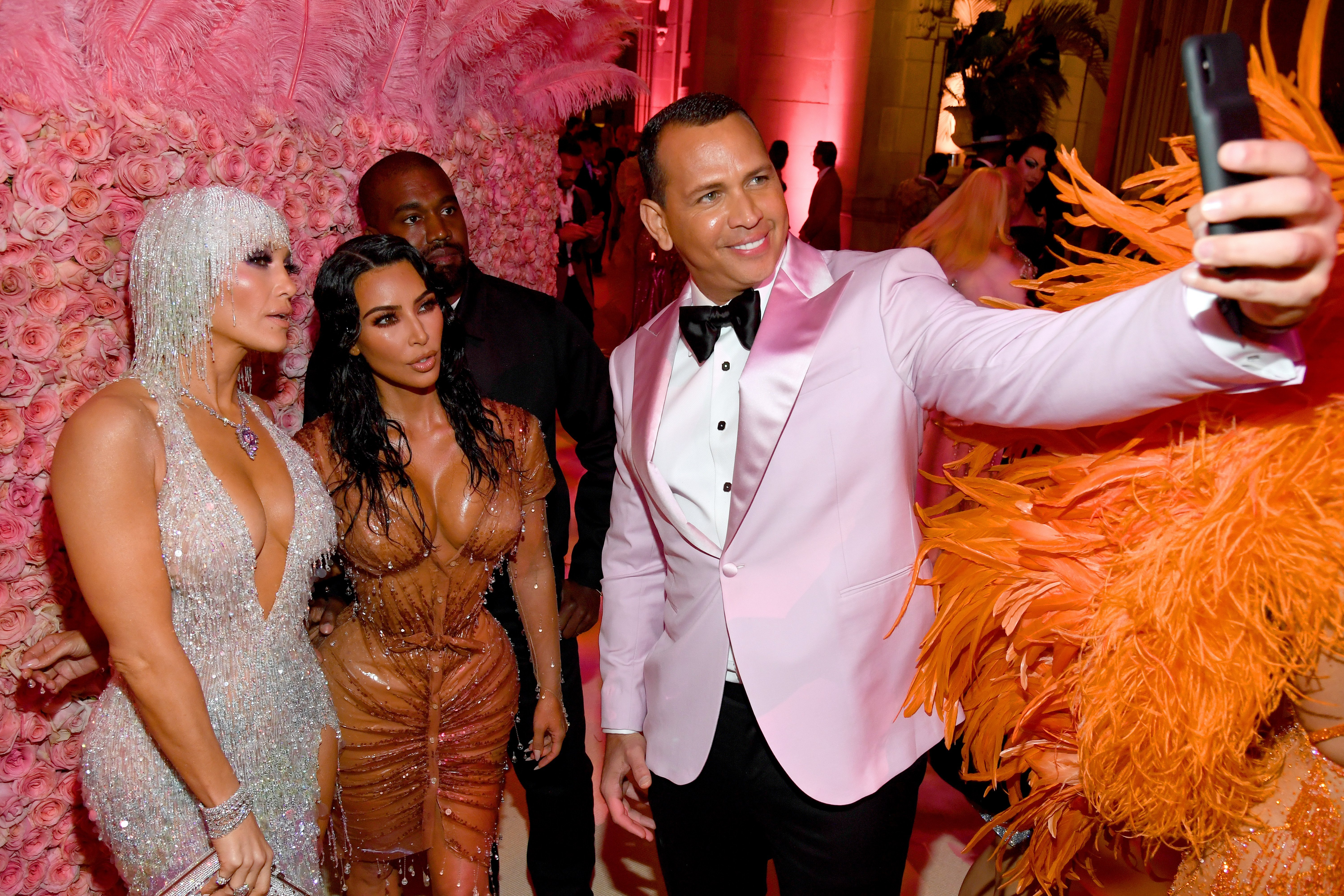 Kim Kardashian and Kanye West posing with Jennifer Lopez and Alex Rodriguez at the 2019 Met Gala | Photo: Getty Images