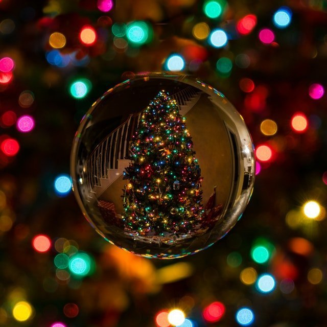 Christmas tree reflected in a crystal ball | Source: Pexels