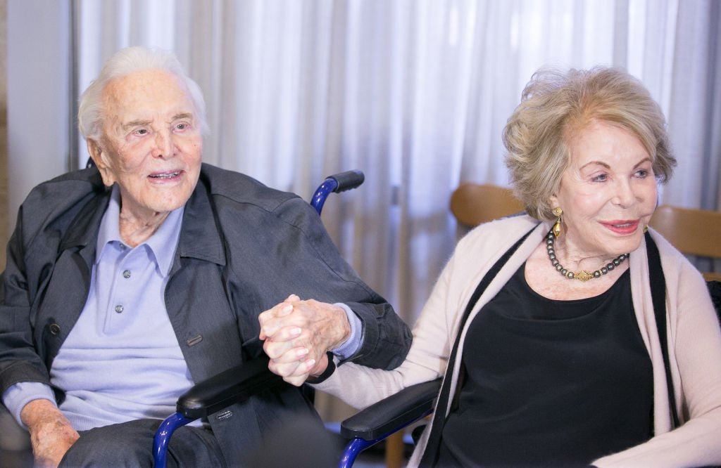 Kirk Douglas and his wife Anne Douglas holding hands. | Photo: Getty Images