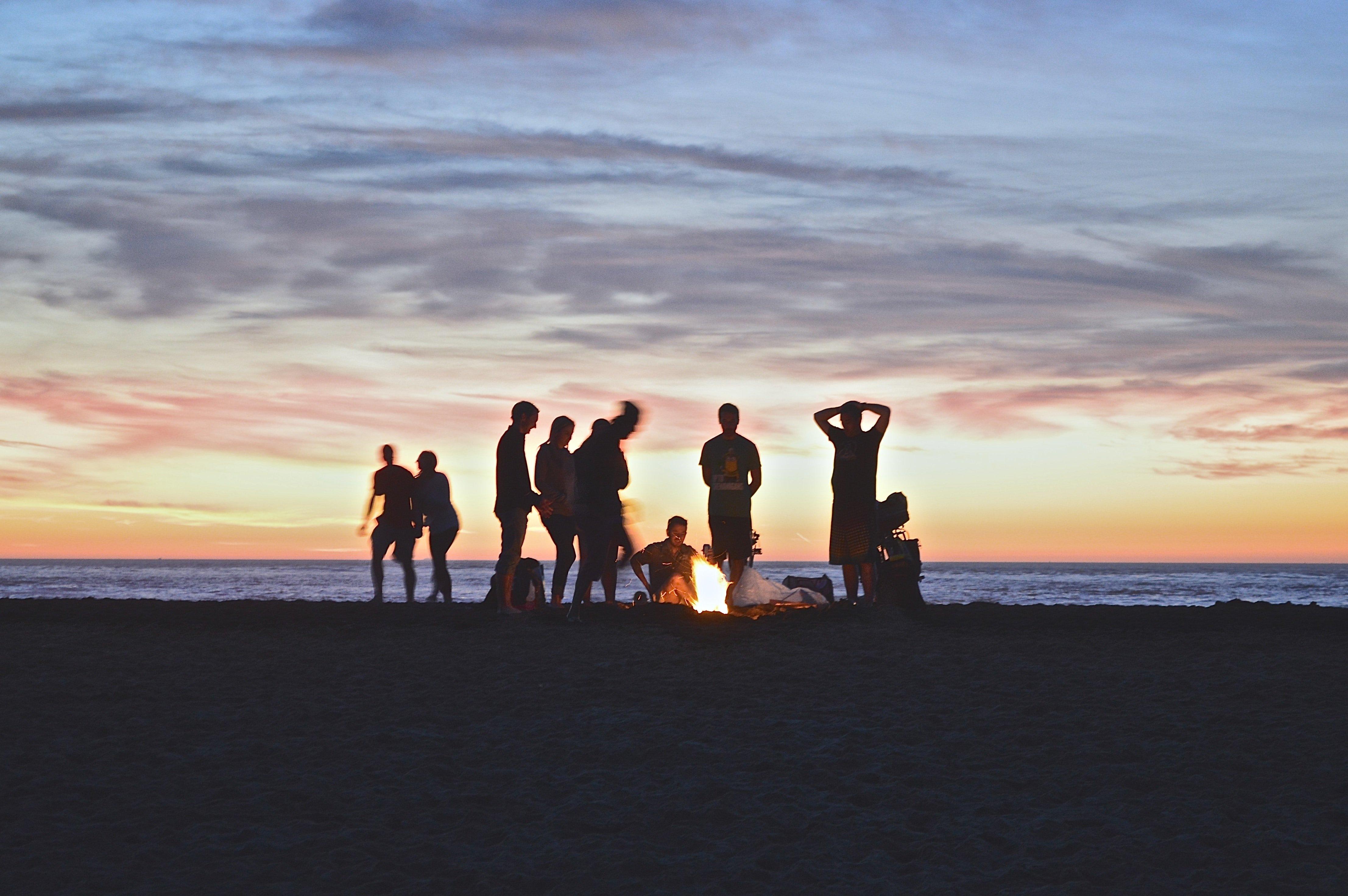 A circle of friends beside a campfire | Source: Unsplash.com