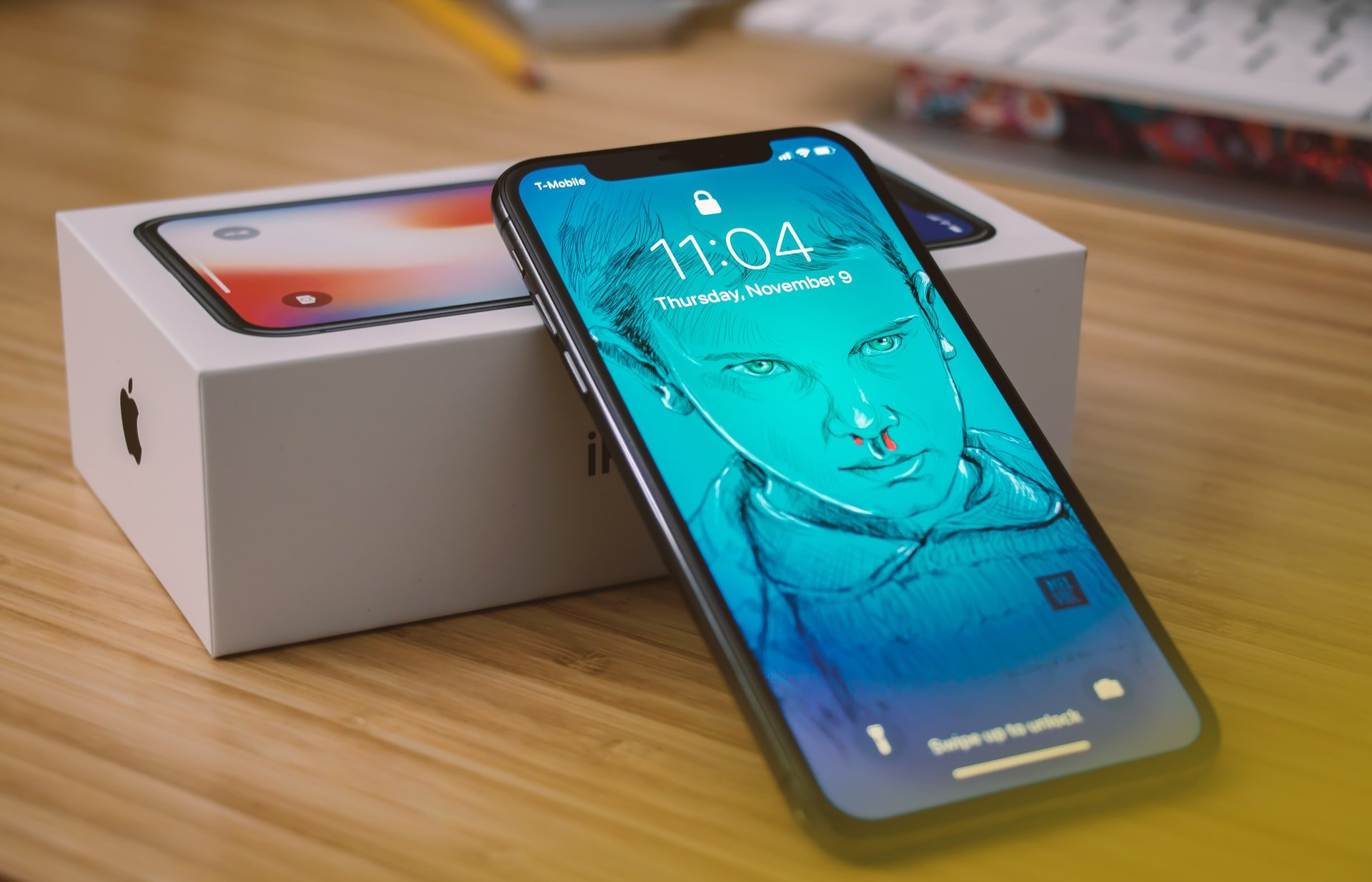 Brand new iPhone X with box on table   Source: Unsplash