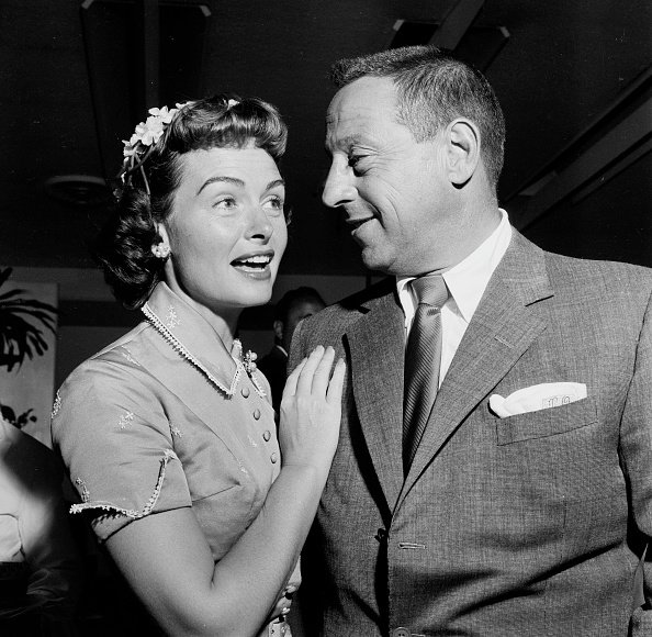 Actress Donna Reed and Tony Owen attend Helen Hayes Party on June 25,1956 in Los Angeles,CA. | Photo: Getty Images