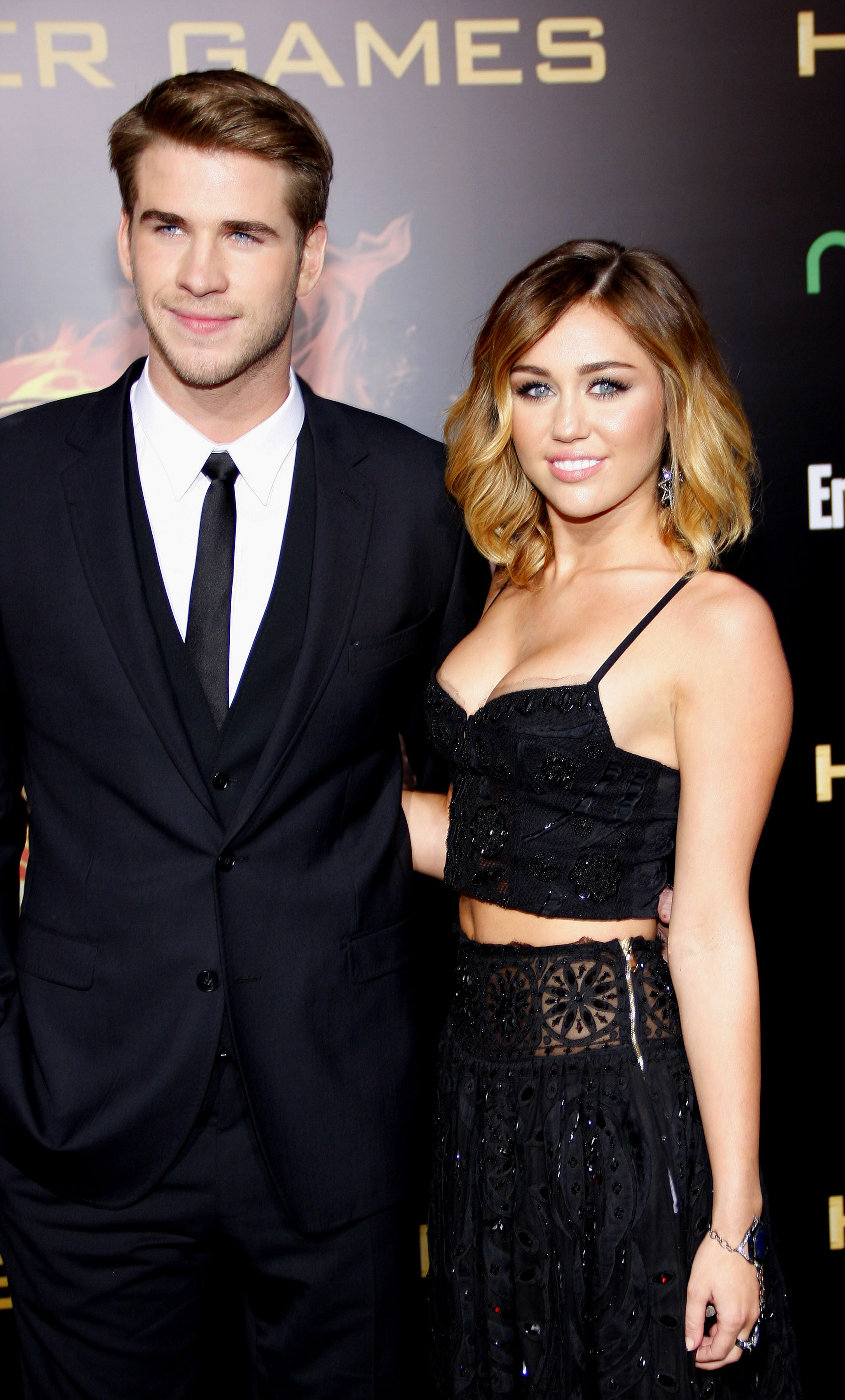 "Miley Cyrus and Liam Hemsworth at the Premiere of ""The Hunger Games"" on March 12, 2012. 