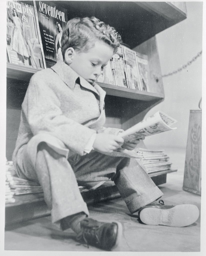 A portrait of Rusty Hamer reading the papers on January 01, 1955   Photo: Getty Images