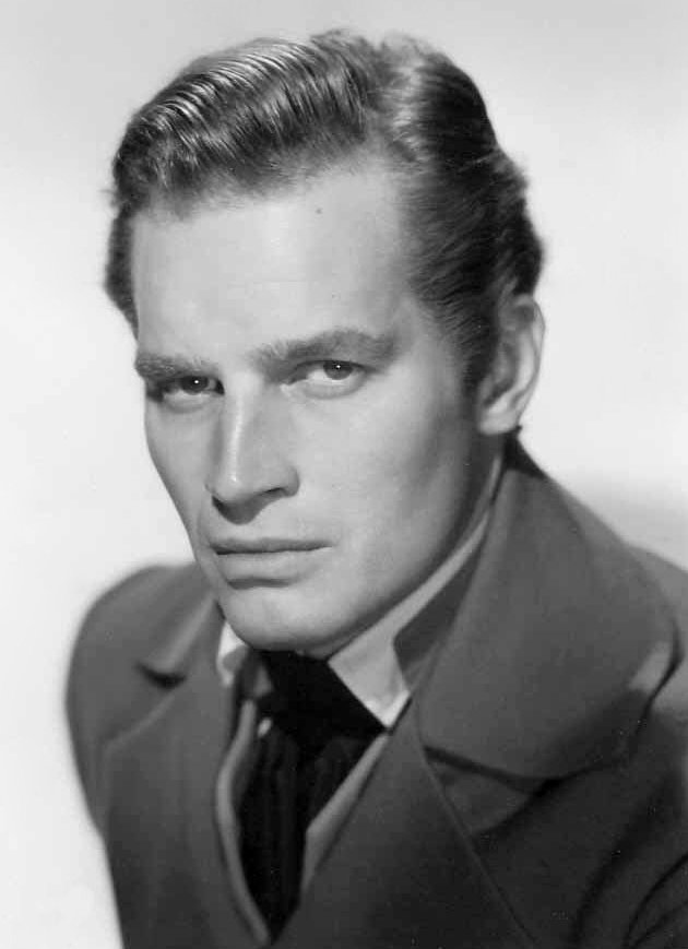 Publicity photo of Charlton Heston for film The President's Lady. c. 1953 | Source: Wikimedia Commons