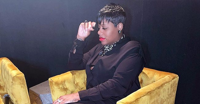 Pregnant Fantasia Stuns Showing Her Cool Tattoos in Black Dress & Heels with Feather Detailing