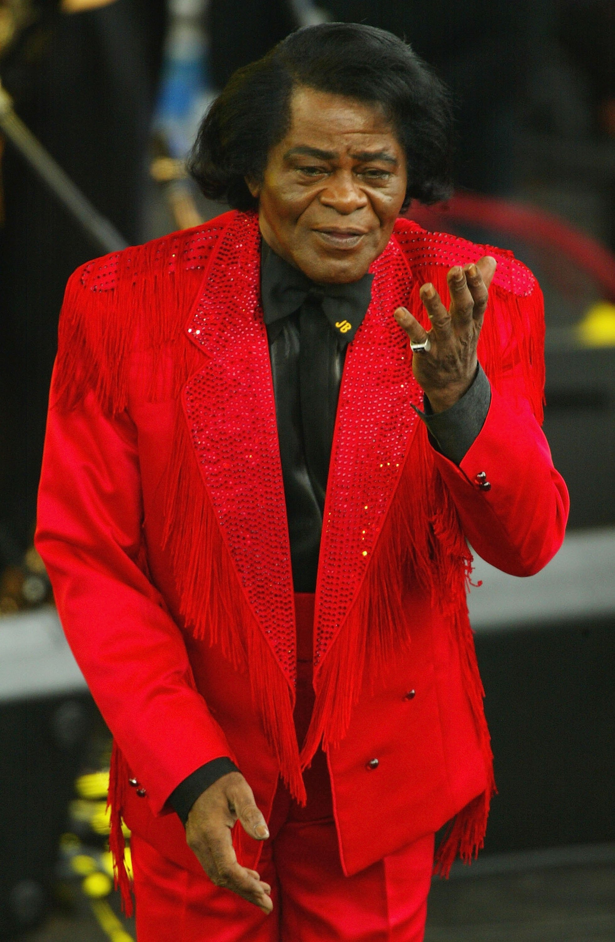 James Brown performs on stage at the Olympic Torch Concert held in The Mall on June 26, 2004.   Photo: Getty Images