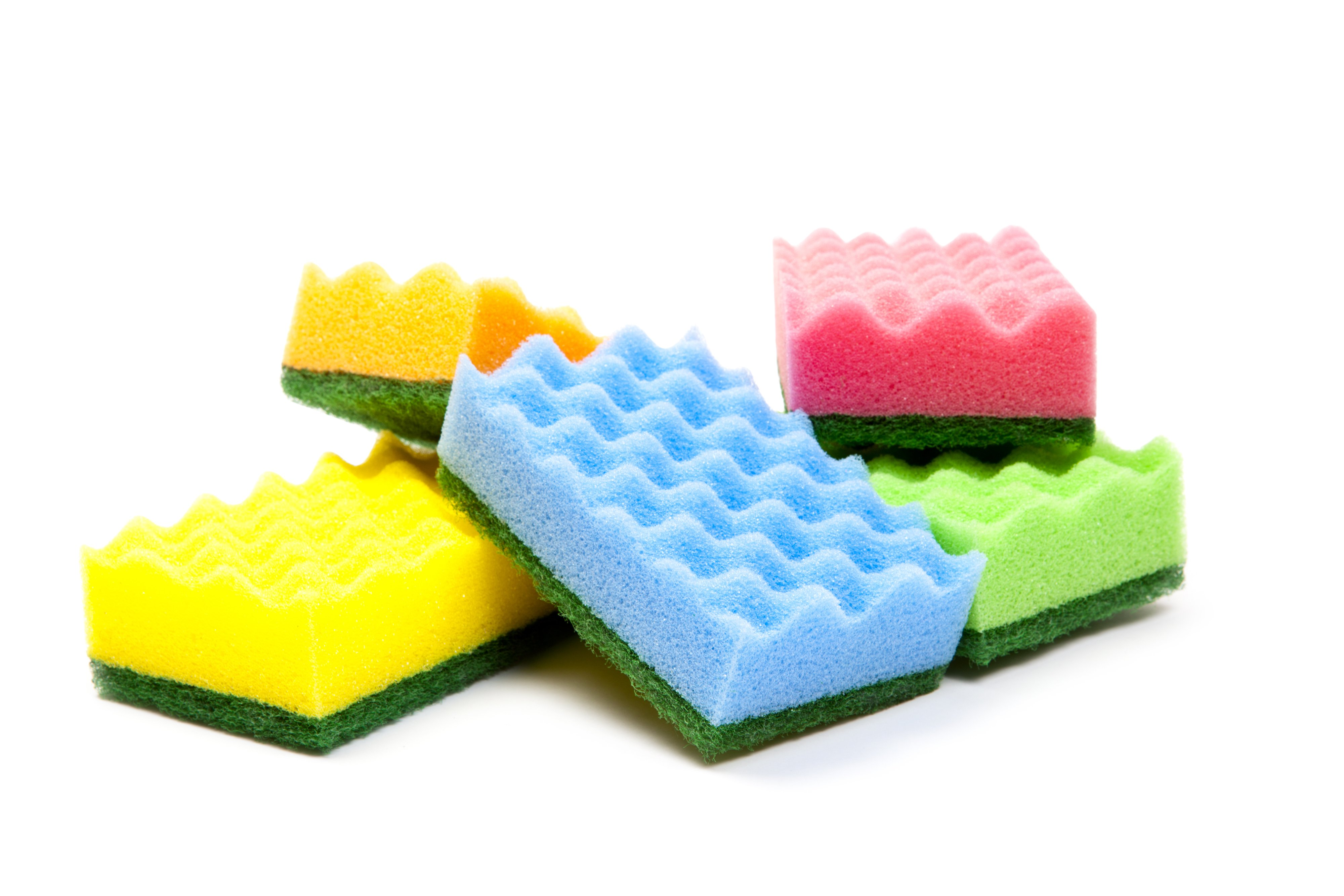 Colorful sponges stacked together | Photo: Shutterstock