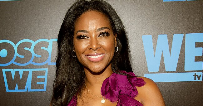 Kenya Moore's Daughter Looks like Mom after Dressing Herself in a Pink Coat with Matching Boots