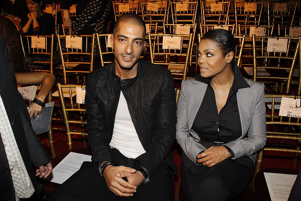 Wissam Al Mana and Janet Jackson attend the John Galliano Ready to Wear Spring/Summer 2011 show during Paris Fashion Week at Opera Comique on October 3, 2010 | Photo: Getty Images
