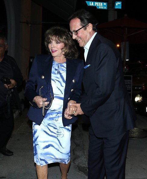 Joan Collins and Percy Gibson are seen on November 14, 2019 in Los Angeles, California | Photo: Getty Images