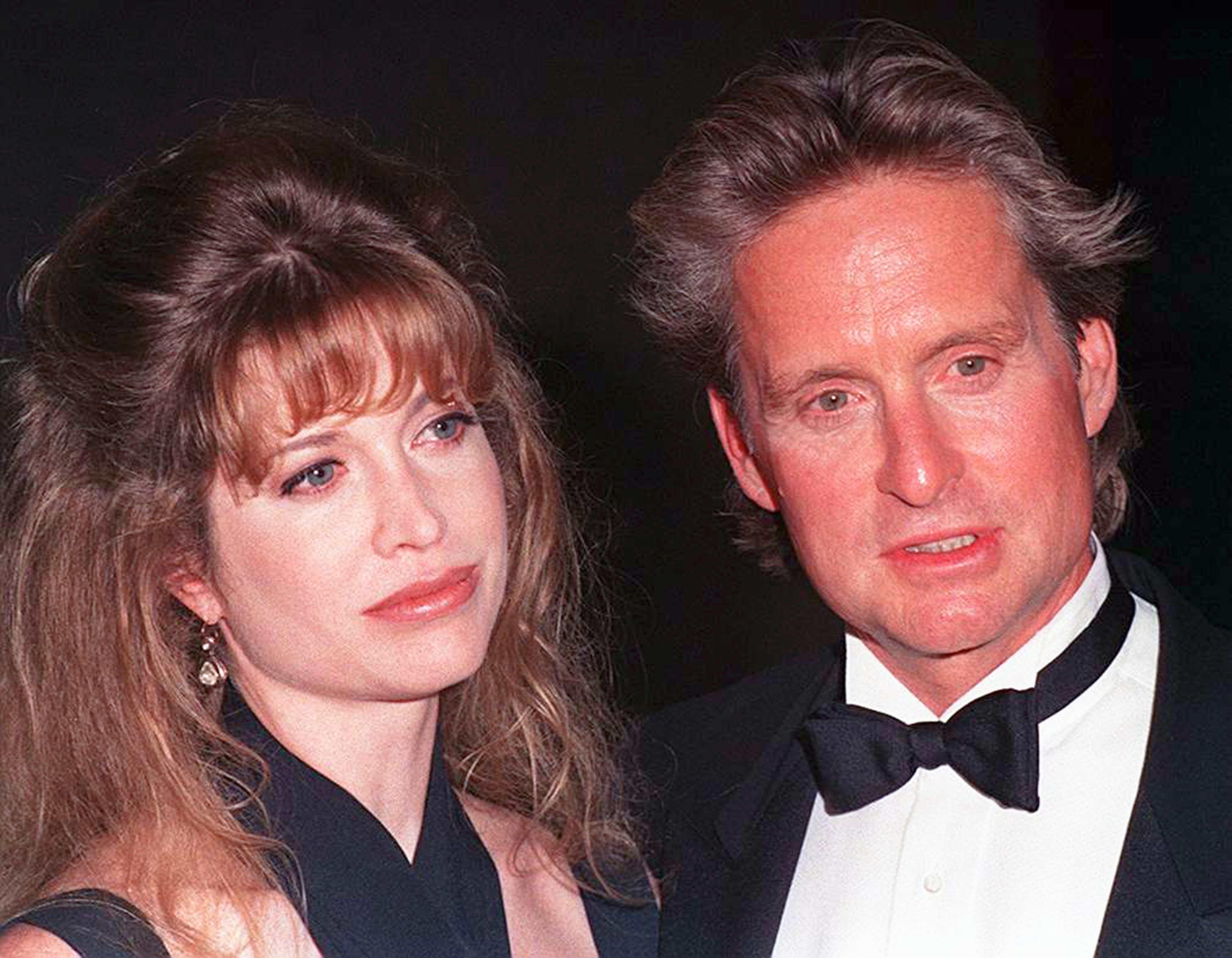 Michael Douglas with his wife Diandra at the American Cinematheque's Eighth Annual Moving Picture Ball in Los Angeles, California, on September 29, 1993. | Source: Getty Images.