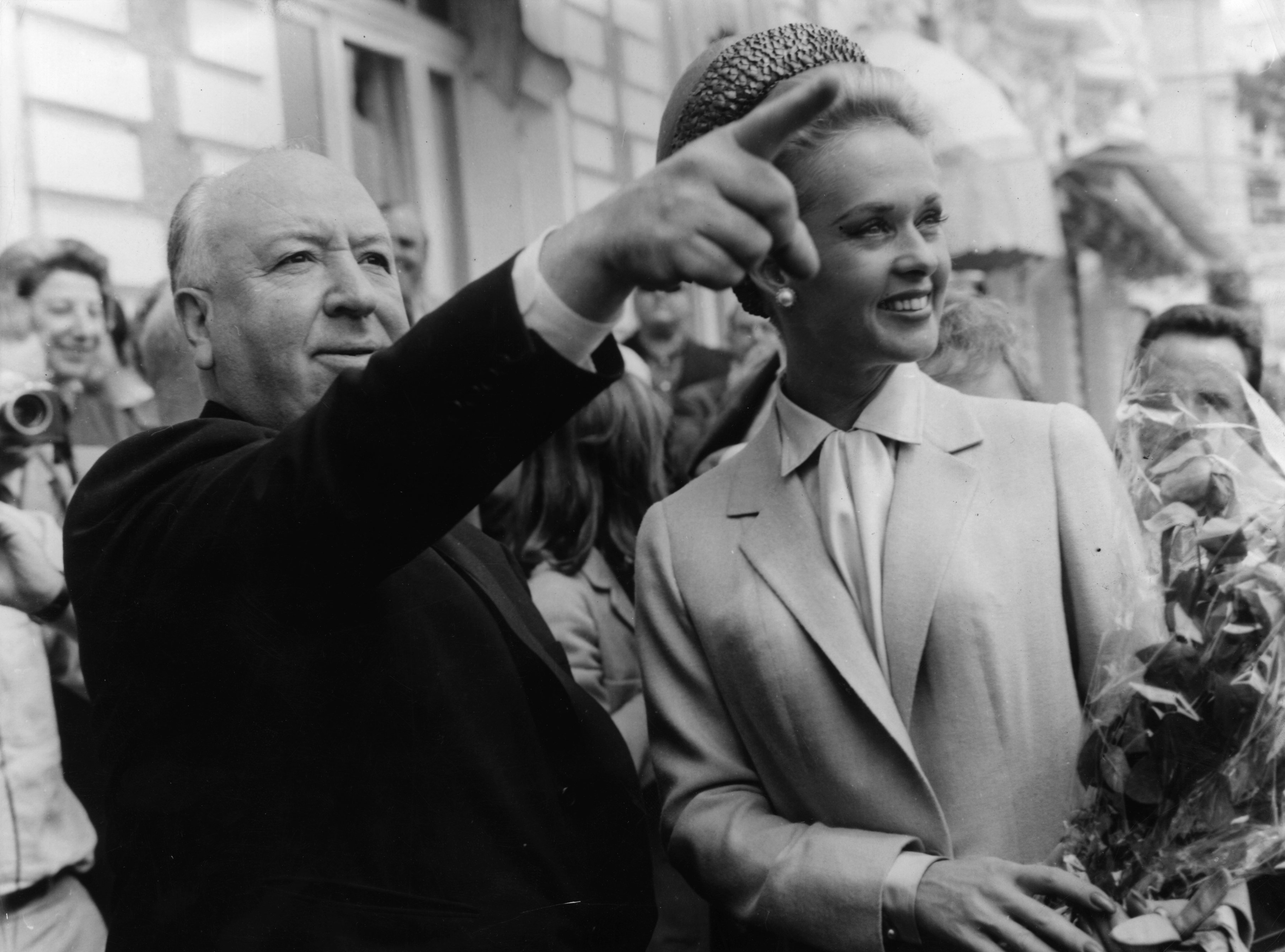 Alfred Hitchcock and American actress Tippi Hedren explore Cannes together after the premiere of his latest thriller 'The Birds' in which she plays the title role.   Source: Getty Images