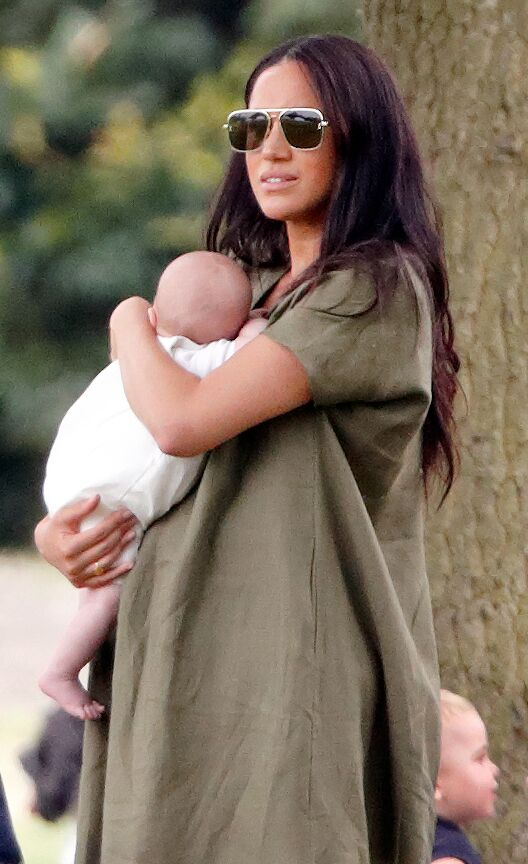 Meghan Markle cradles baby Archie. | Source: Getty Images