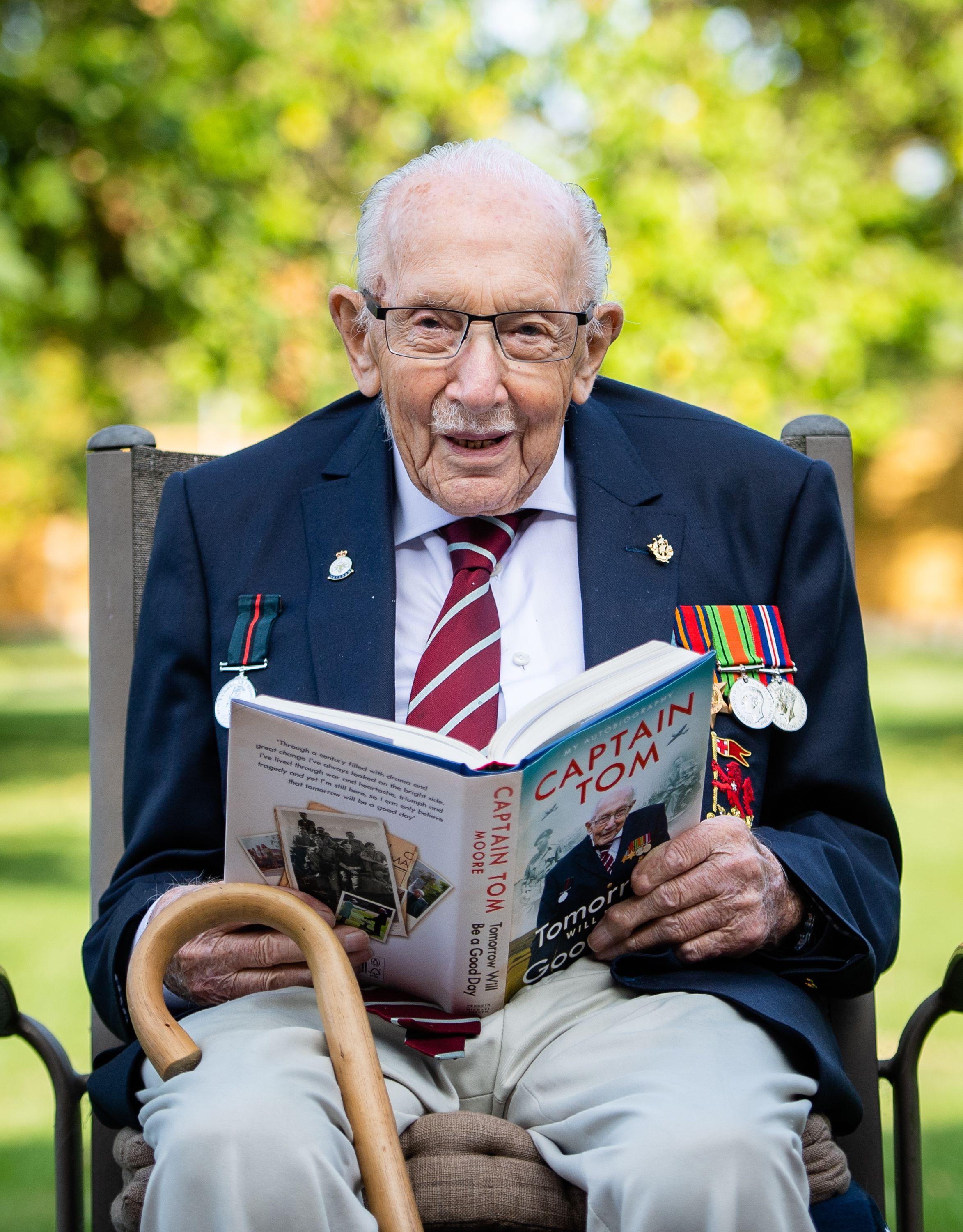 "Captain Sir Tom Moore poses during a photocall to mark the launch of his memoir ""Tomorrow Will Be A Good Day"" on September 17, 2020, in Milton Keynes, England 