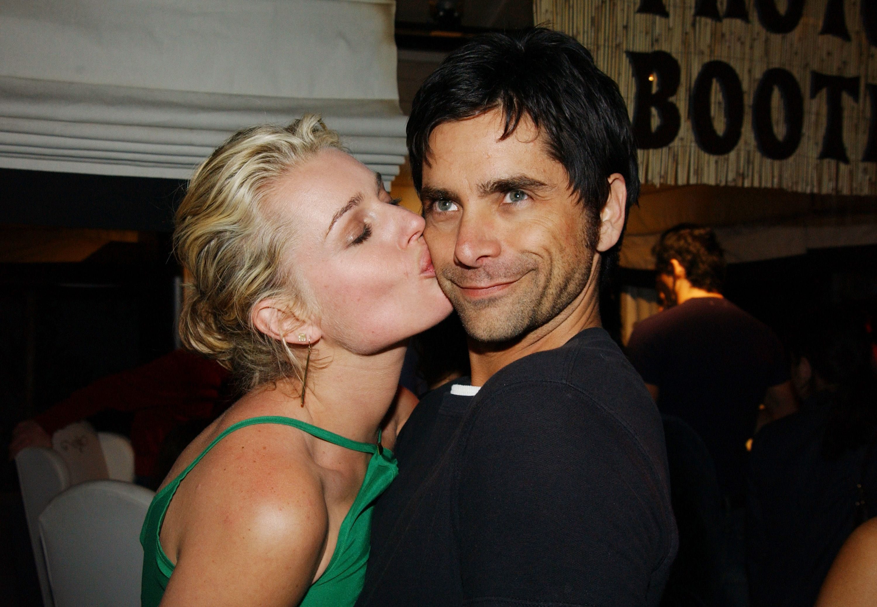 """Rebecca Romijn and John Stamos at the PlayStation 2 """"Bungalow Beach Party"""" in 2003 in Santa Monica, California 