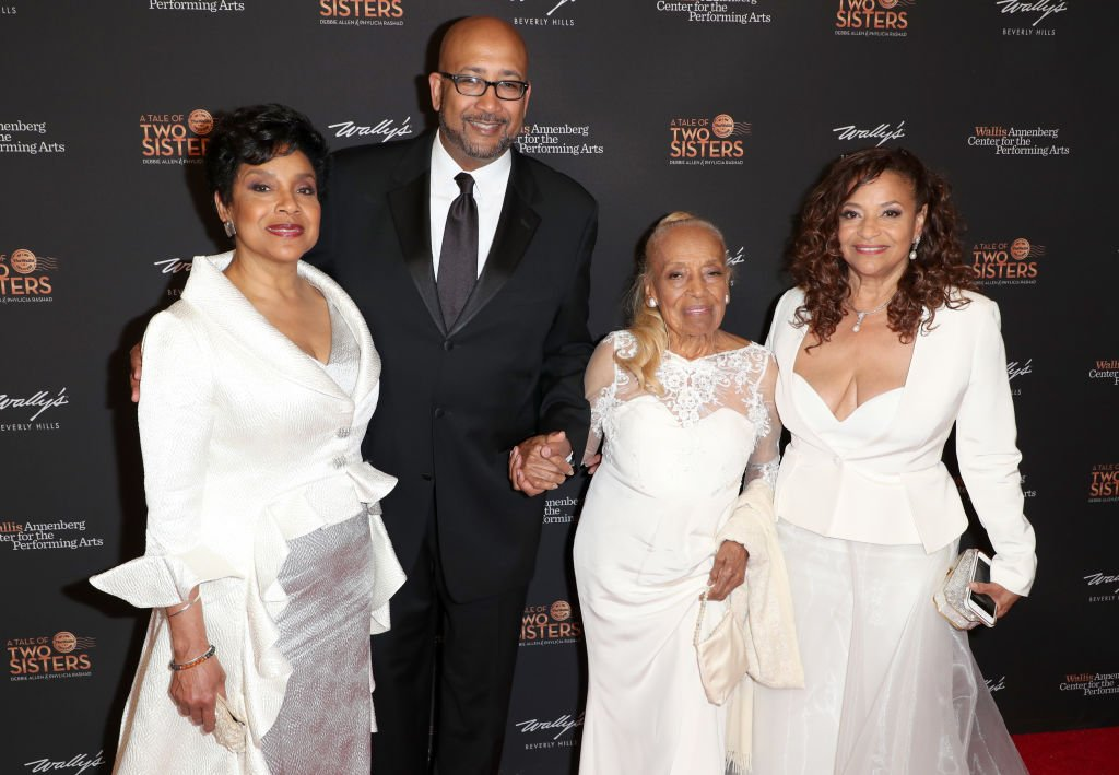 "Phylicia Rashad, Andrew Arthur Allen Jr., Vivian Ayers Allen, and Debbie Allen pose on the red carpet for ""A Tale of Two Sisters,"" honoring Debbie Allen and Phylicia Rashad in 2018. 