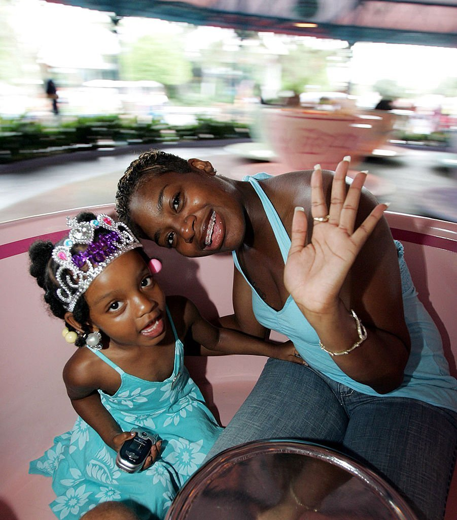 """American Idol"" winner in 2004 Fantasia Barrino celebrates her daughter Zion's fourth birthday while taking a spin in a Mad Tea Party teacup in Fantasyland at Walt Disney's Magic Kingdom 