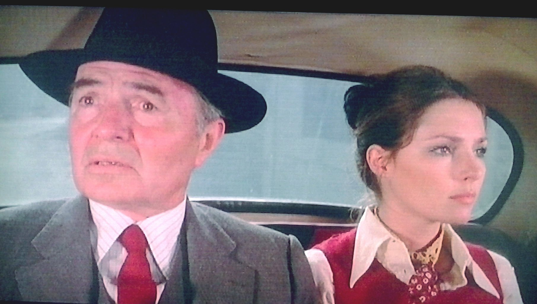 """James Mason and Jennifer O'Neill in a frame of """"People of respect"""" (Zampa, 1975). 