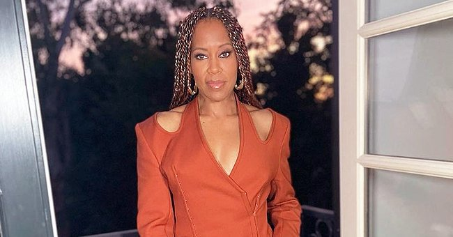Regina King Turns Heads Flaunting Her Toned Legs in an Orange Mini Dress with Silver High Heels