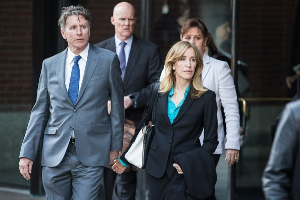 Felicity Huffman exits federal court in Boston, Massachusetts, U.S. | Photo: Getty Images