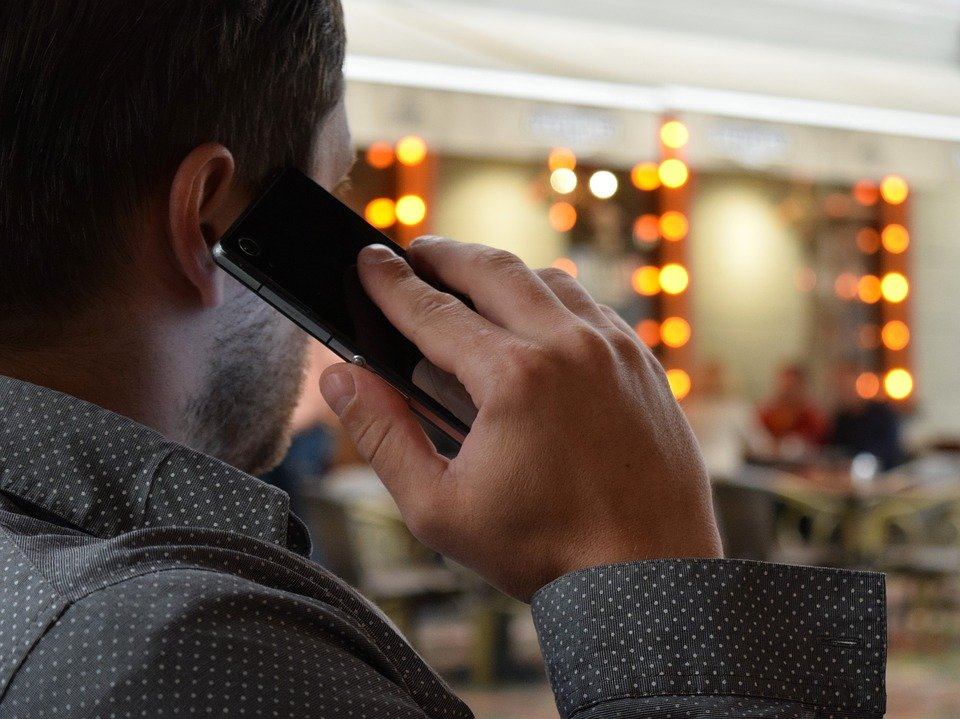 A photo of a man on the phone.   Photo: Pixabay