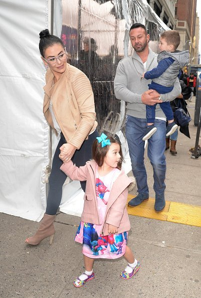 Roger Mathews, Jenni 'JWoww' Farley and Meilani Mathews walking Midtown in New York City.| Photo: Getty Images.