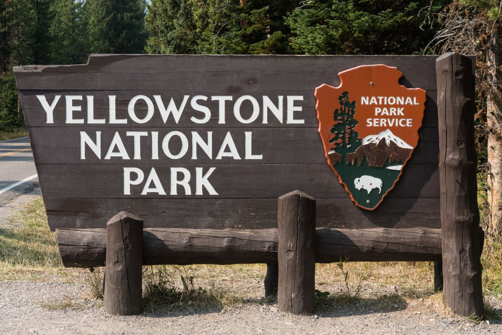 A portrait of the wooden entrance sign to Yellowstone National Park, USA on September 16, 2020   Photo: Getty Images