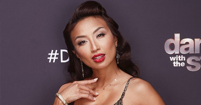 DWTS Contestant Jeannie Mai Looks Cool Posing in a Cooper-Gold Dress with a Thigh-High Slit