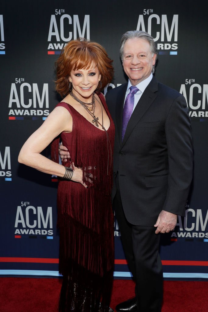 "Reba McEntire and Anthony ""Skeeter"" Lasuzzo attend the 54th Academy Of Country Music Awards at MGM Grand Garden Arena. 