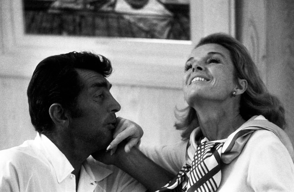 American singer, actor, comedian, and producer Dean Martin (1917-1995) and his wife Jeanne Martin (1927-2016) have a laugh at home circa November, 1967 in Los Angeles | Source: Getty Images