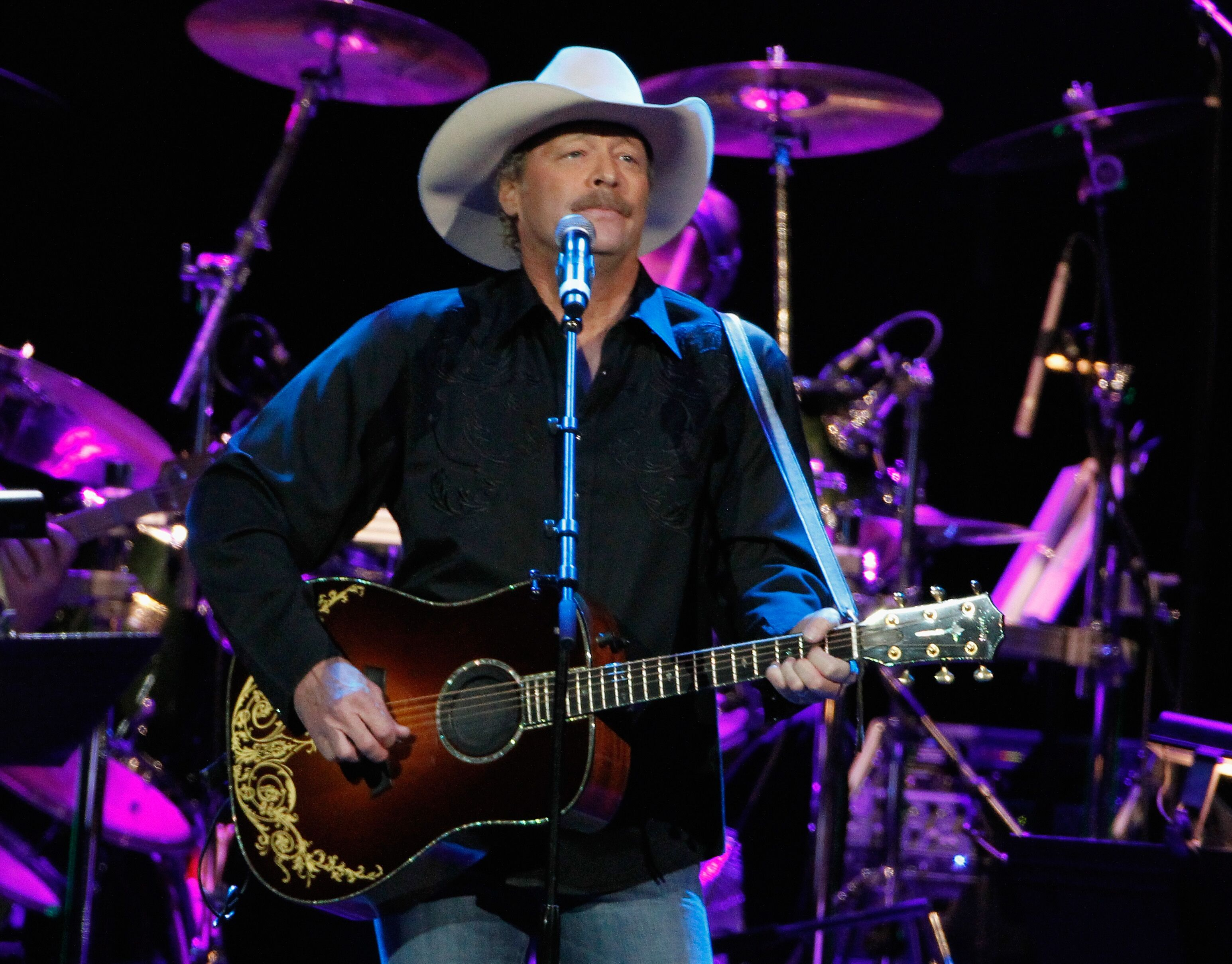 Alan Jackson performs during Playin' Possum! The Final No Show Tribute To George Jones - Show at Bridgestone Arena on November 22, 2013 in Nashville, Tennessee. | Source: Getty Images