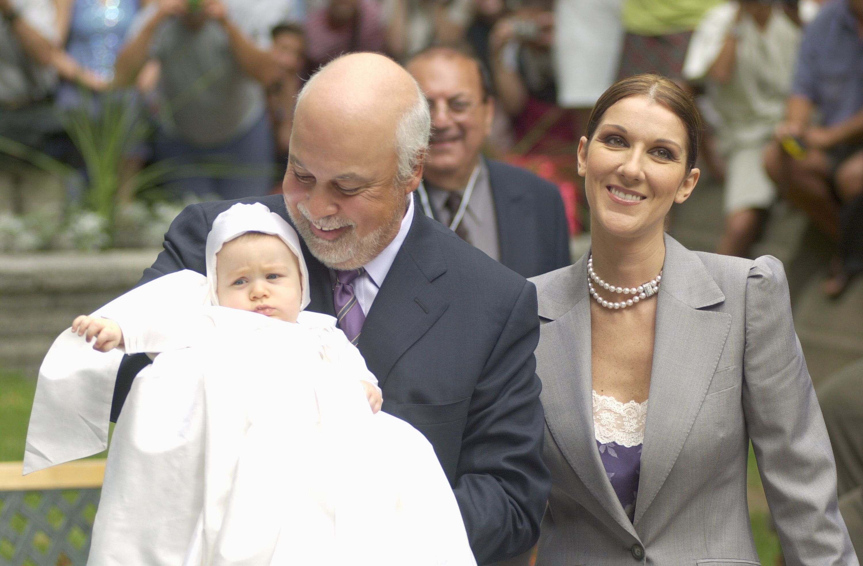 Celine Dion and husband Rene Angelil with their baby Rene-Charles outside the chapel of the Notre-Dame Basilica in Montreal | Source: Getty Images