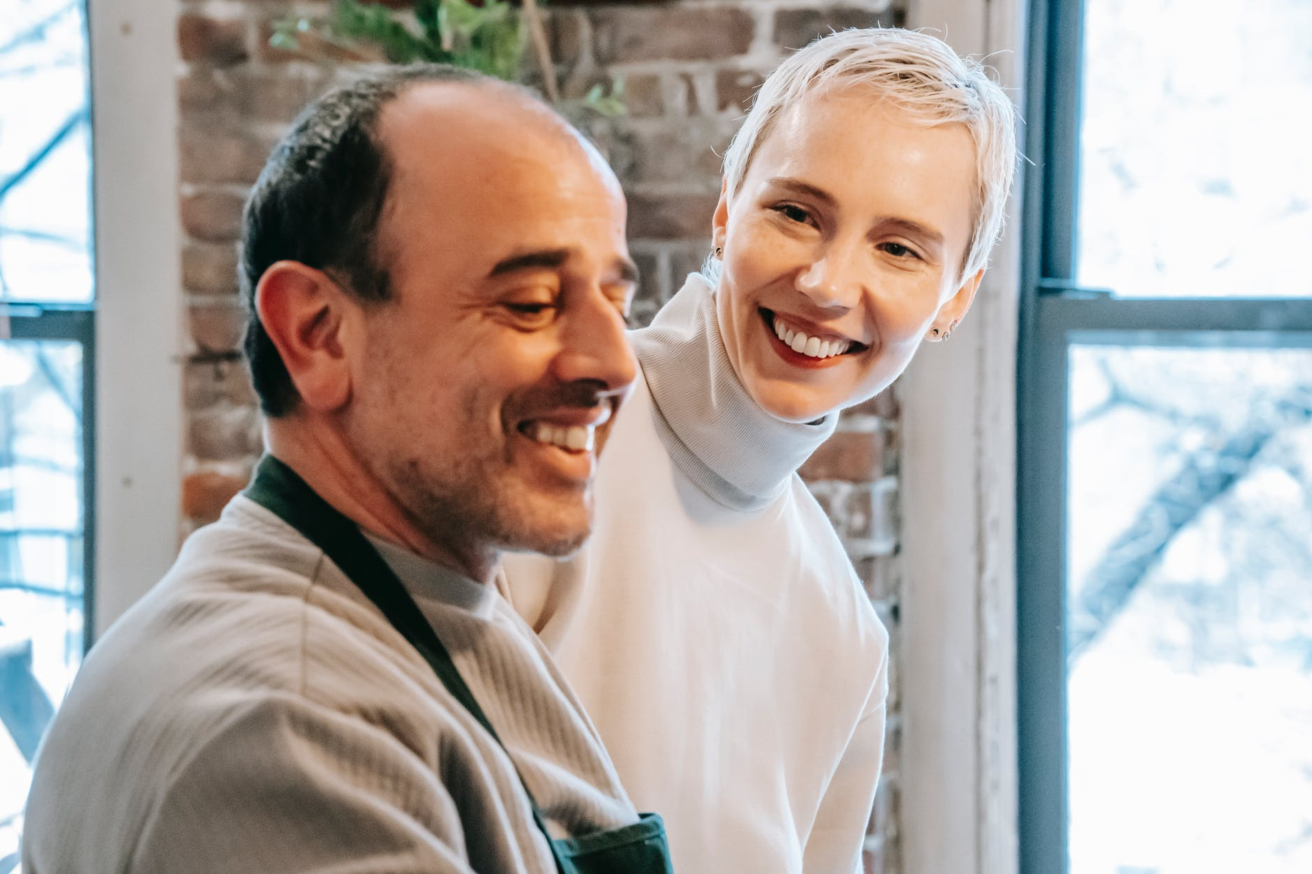 A woman smiling at a smiling man beside her. | Source: Pexels