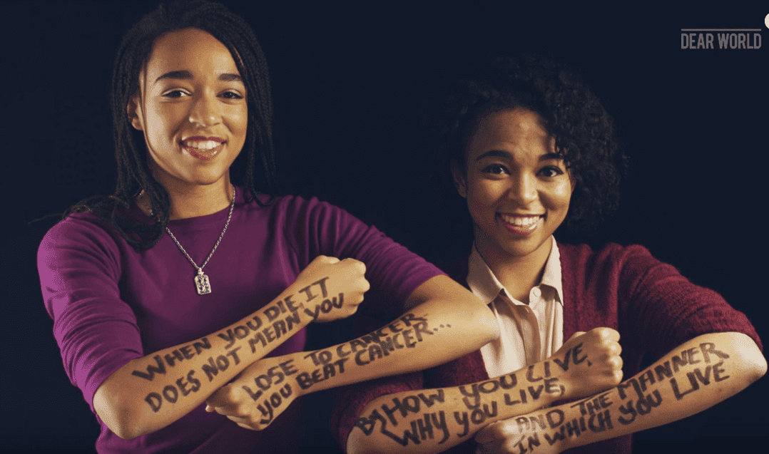 Screenshot of Taelor and Sydni Scott in a tribute video for their dad in Jan. 2016, one year after his death. | Photo: YouTube/ Dear World