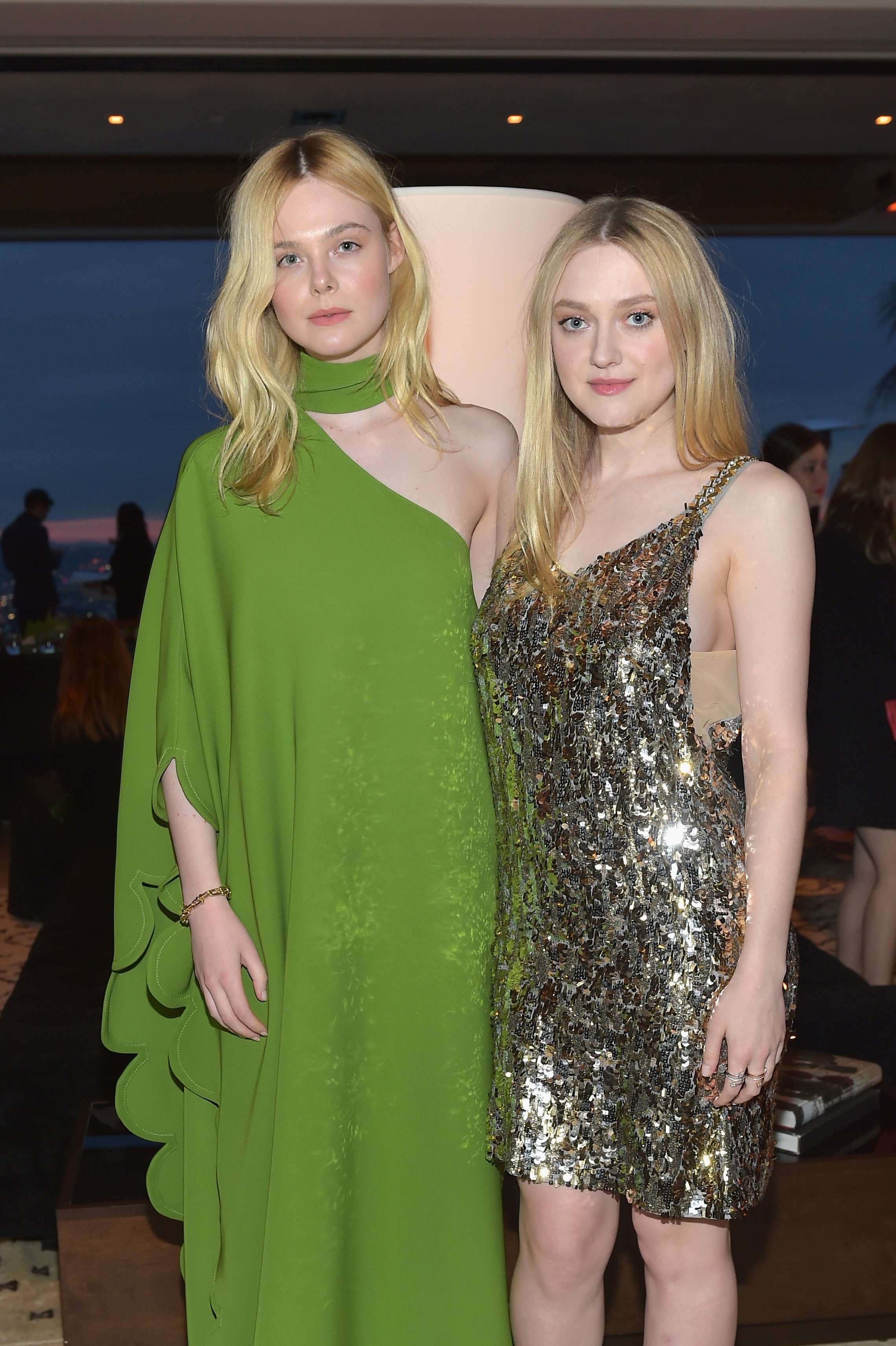 Elle and Dakota Fanning pictured at The Hollywood Reporter and Jimmy Choo Power Stylists Dinner, 2018, Los Angeles, California. | Photo: Getty Images