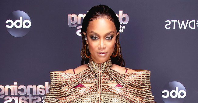 Tyra Banks Puts Her Massive Cleavage on Display While Posing in a Tight Black Corset