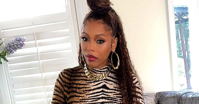 Lil Scrappy's Wife Bambi Puts Her Growing Baby Bump on Display Posing in a Tiger-Print Romper